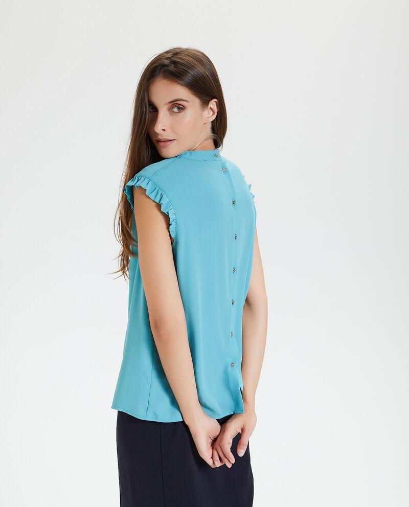 Blusa in tinta unita con chiusura con bottoni sul retro donna