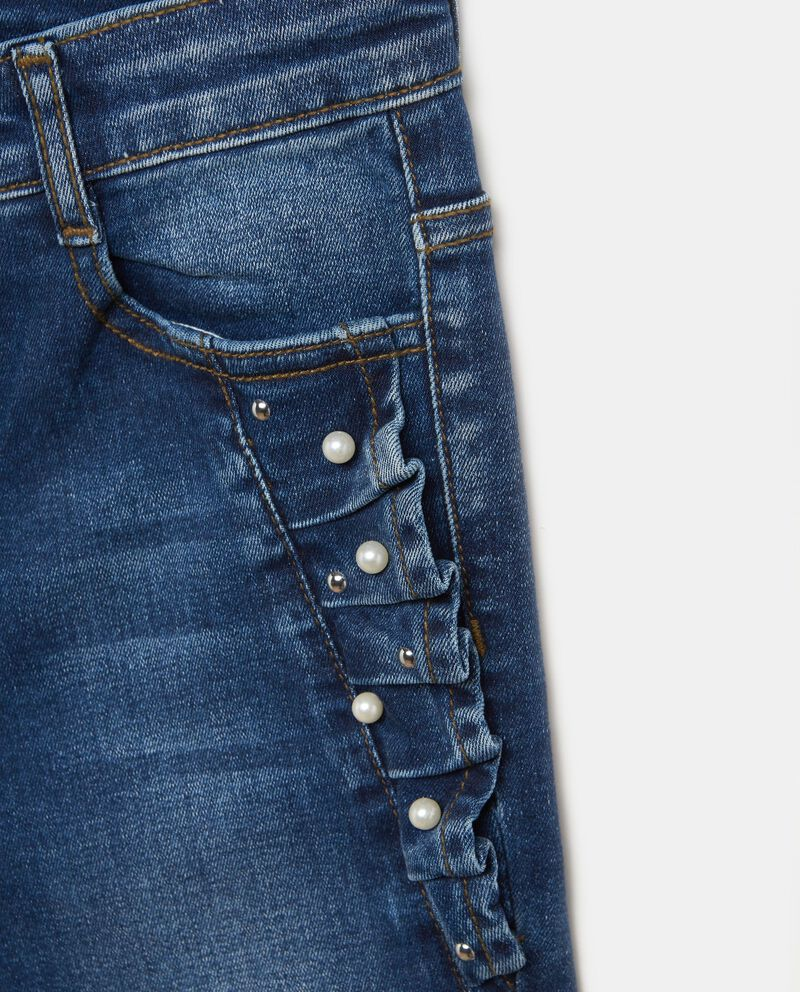 Jeans stretch con volant e perline