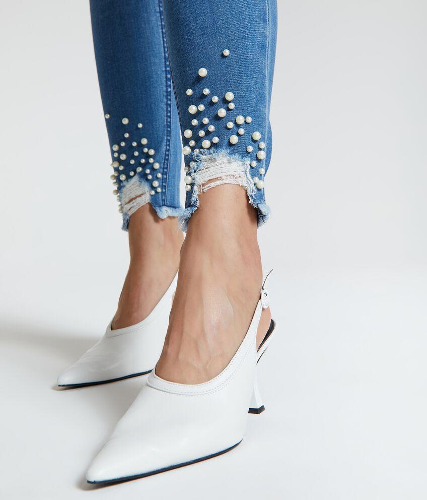 Jeans perline sul fondo