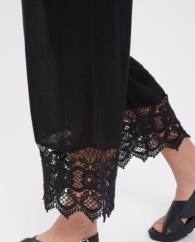 Pantaloni in cotone con passamaneria