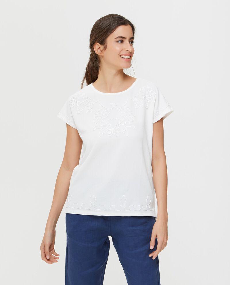 T-shirt tinta unita con ricami in tono