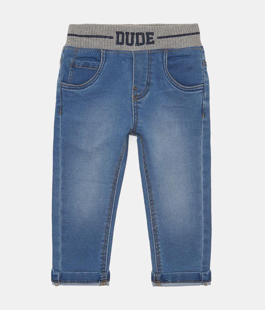 Jeans effetto used con inserto elasticizzato in vita