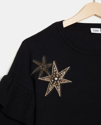 Maglioncino con stelle sul fronte ragazza