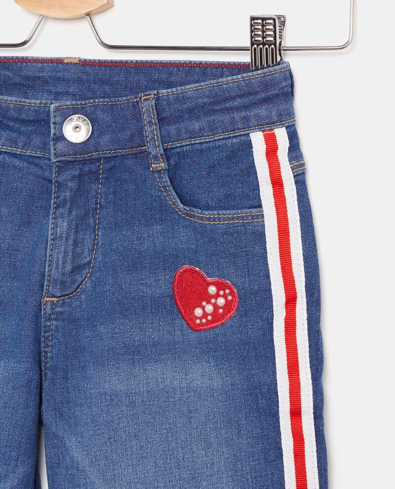 Jeans ampi con bande laterali bambina