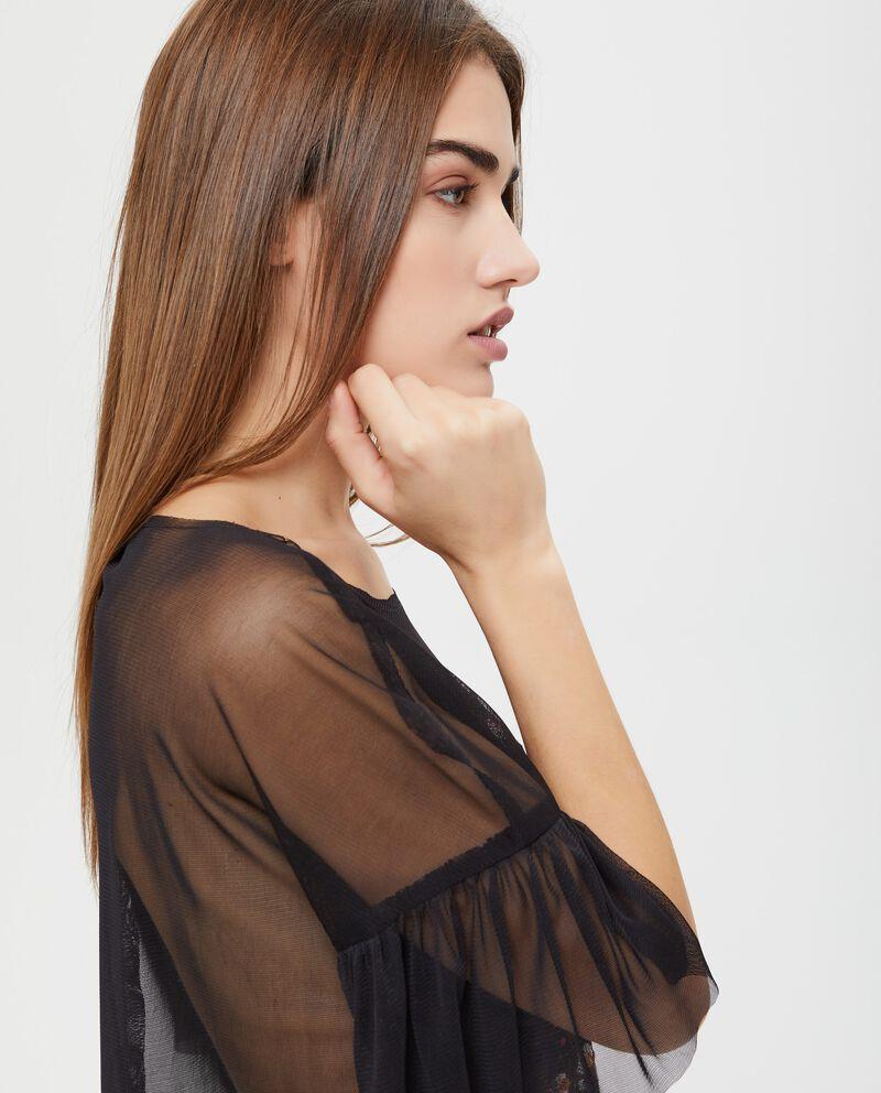 Blusa semitrasparente ricami floreali