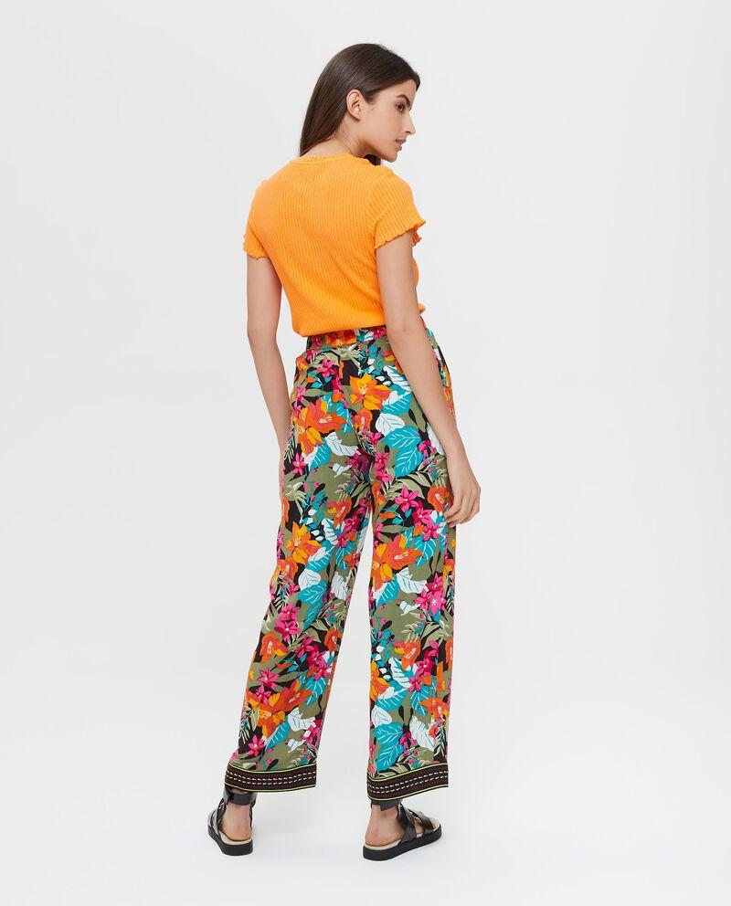 Pantaloni floreali con passamaneria