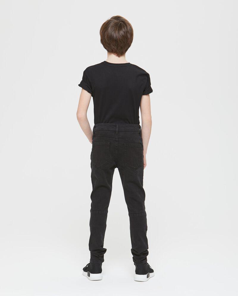 Jeans stretch effetto used con tagli