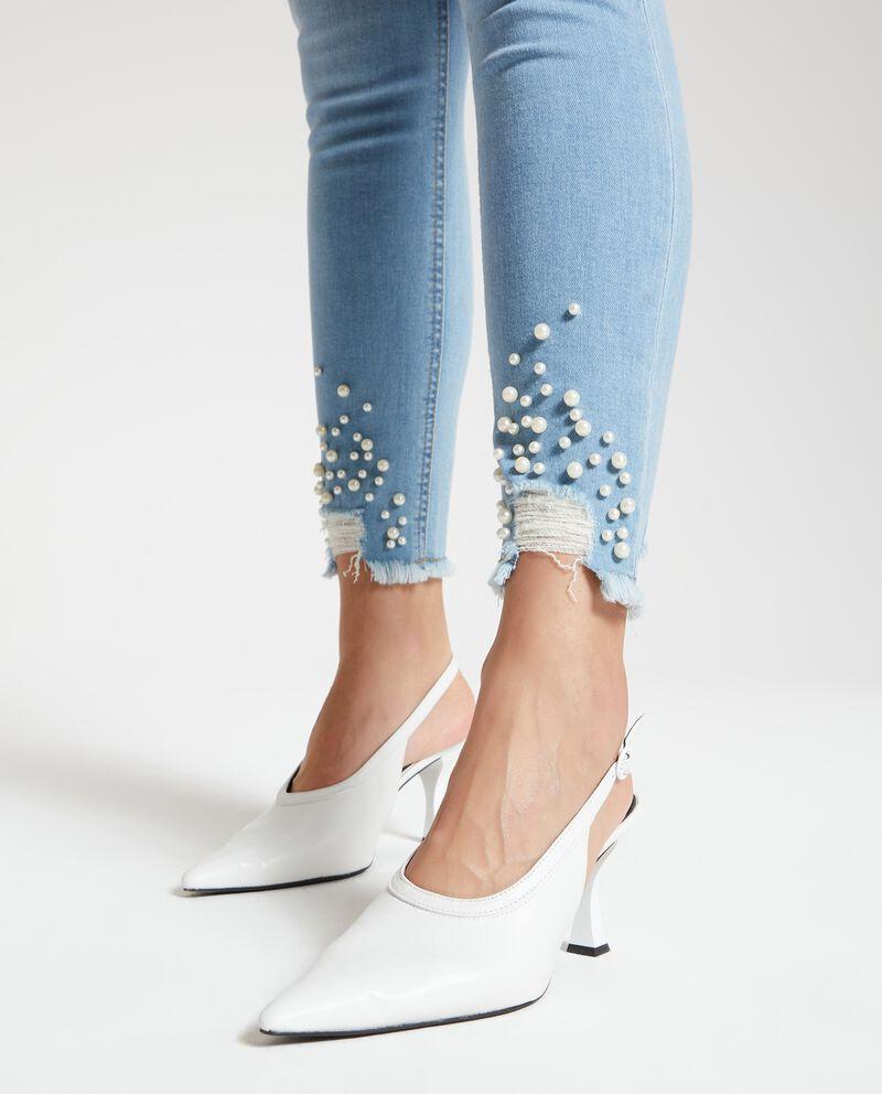 Jeans con perline sul fondo